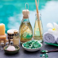 Spa and wellness massage setting. Still life with essential oil, salt and stones