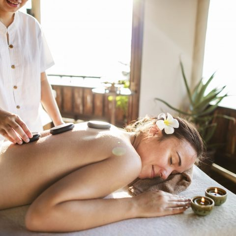 Woman getting a hot stone massage
